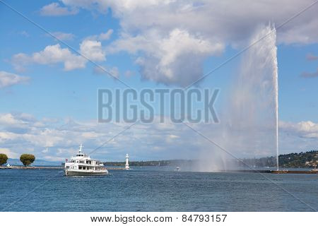 Tourist Ship Floats Across Lake Geneva By The Jet D'eau Fountain