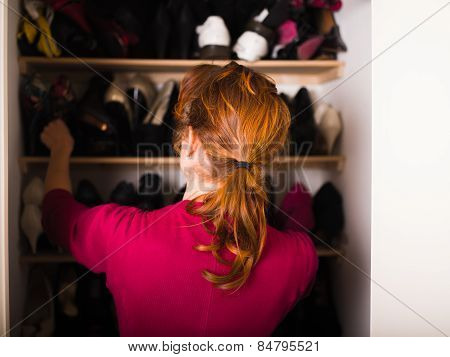 Woman Organizing Her Shoes