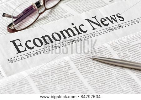 A Newspaper With The Headline Economic News