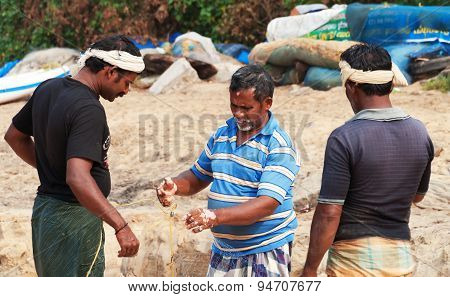 Indian Fishermen With Fishing Net On Beach In Varkala