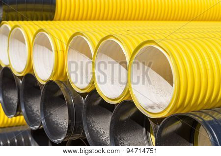 Stack Of Corrugated Plastic Pipes