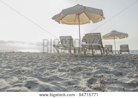 Sandy beach on Greek Kos island with parasols and sunbeds