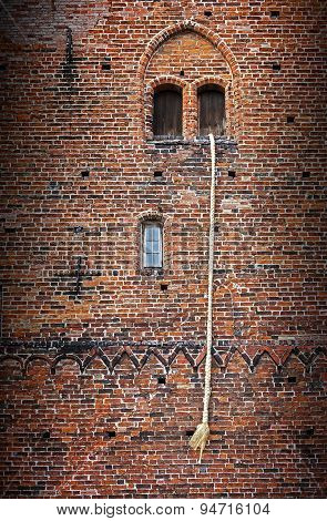 Rapunzel Story, A Long Blond Hair Plait Hanging Out Of The Window Of An Old Brick Tower