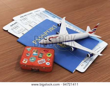 Travel Concept. Passports, Airline Tickets, Airplane And Suitcase On The Wood Background.