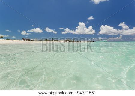 Beautiful Skyline Over The Clear Water Beach.