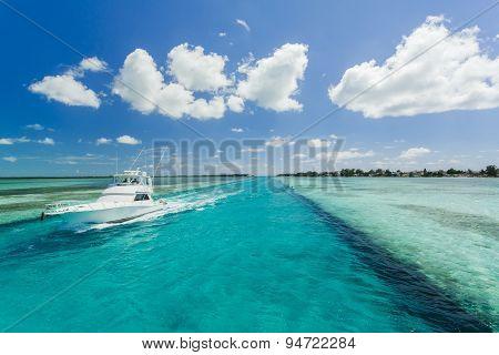 Image Of A Fishing Boat Sailing Along The Beach