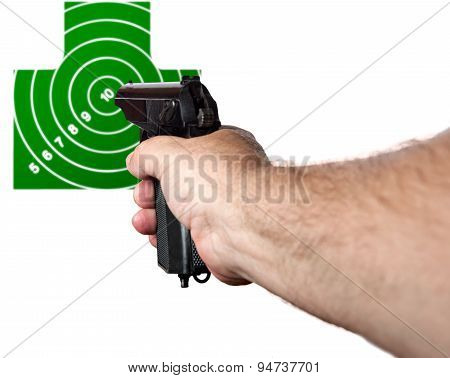 Hand with a gun aimed at the target