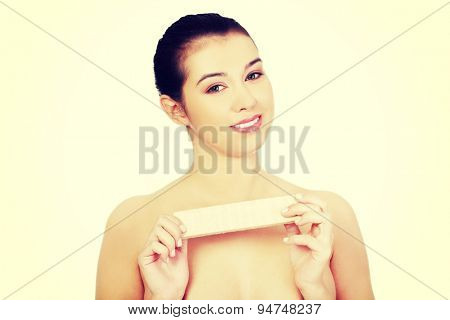 Beautiful woman holding a waffer