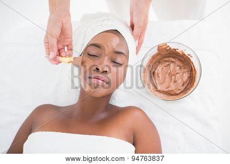Pretty woman getting a chocolate facial treatment at the health spa