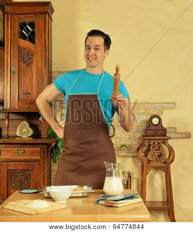man in the kitchen with rolling pin