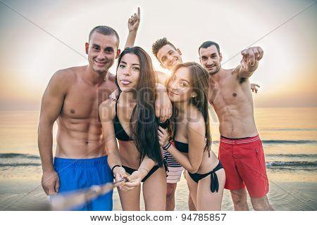 Friends Taking A Selfie On The Beach