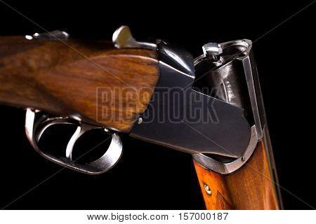 Double-barreled old shotgun on a black background