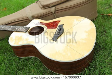 acoustic guitar on grass / acoustic guitar in the park