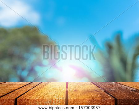Image Of Wood Table And Blur Coconut Tree .