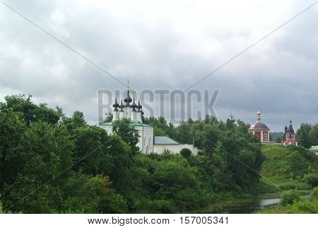 View of the Suzdal Kremlin (XII century). Church of the Entry into Jerusalem and Church of the Assumption - in the center of Suzdal. Gold ring of Russia. Orthodox architecture