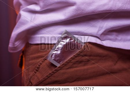 Closeup of condom in pocket. Safety sex concept.