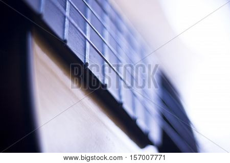 Spanish traditional flamenco wooden acoustic guitar strings and fretboard.