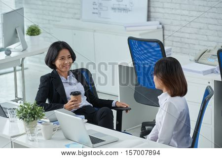 Intern telling her ideas to her chief