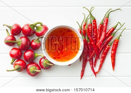 Red chili peppers and chili sauce. Top view.