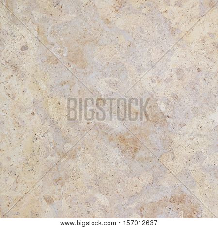 Granite stone wall background texture. Beautiful beige granite background with natural pattern.