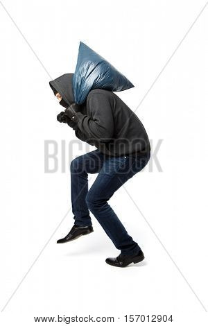 Robber slinking with large bag