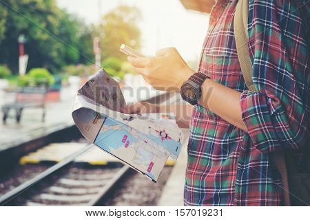 Young Tourist With A Beard Holding A Map Travel Concept