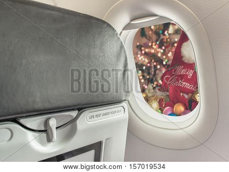 Plane Window And Christmas Ornaments .