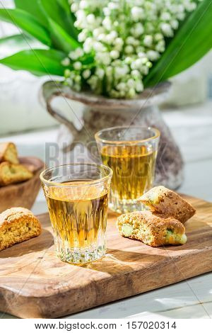 Delicious Cantuccini With Vin Santo On Old Wooden Table