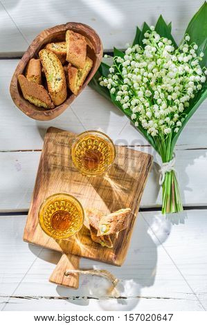 Sweet Cantucci With Wine On Old Wooden Table