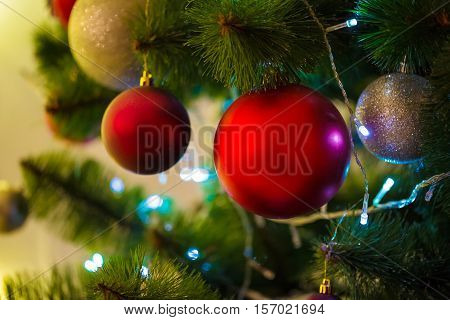 Closeup Of Christmas-tree Background In The Living Room Of The House With Glowing Stars On The Wall