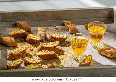 Tough And Sweet Cantuccini With Wine On Old Wooden Table