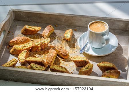 Italian Cantuccini With Coffee On Old Wooden Table