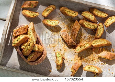 Italian Cantuccini With Vin Santo On Old Wooden Table