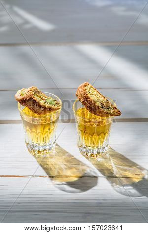 Italian Biscotti With Wine On Old Wooden Table