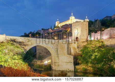 Alcantara Bridge or Puente de Alcntara . Stone arch bridge in the city Toledo. Spain. Castilla la Mancha.