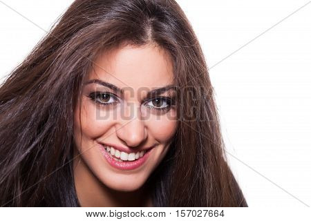 Portrait of Confident Young Woman Smiling Close up at White Background