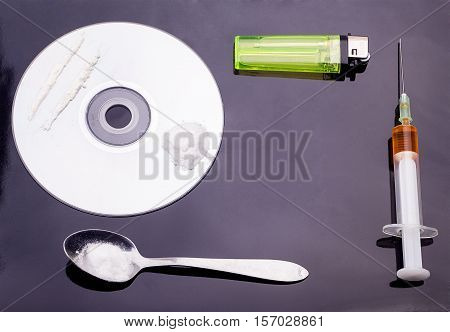Сocaine In The Dvd Drive With A Spoon, Lighter And Syringe