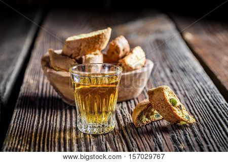 Crispy Cantucci With Wine On Old Wooden Table