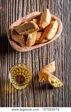 Crispy Cantuccini With Wine On Old Wooden Table