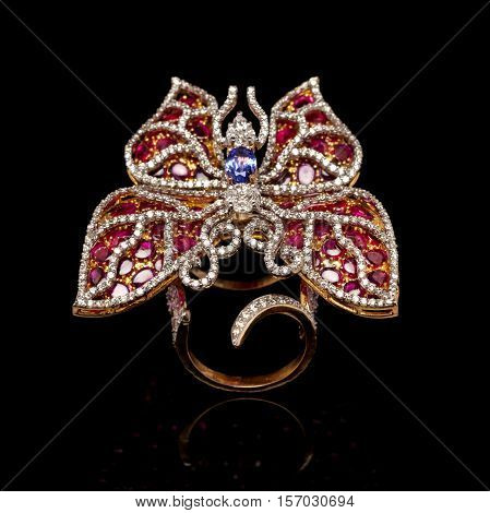 Close up of beautiful Diamond Ring like butterfly , with many different precious Gemstone over black background