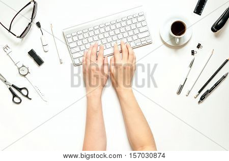 Minimal workspace with keyboard, black and white