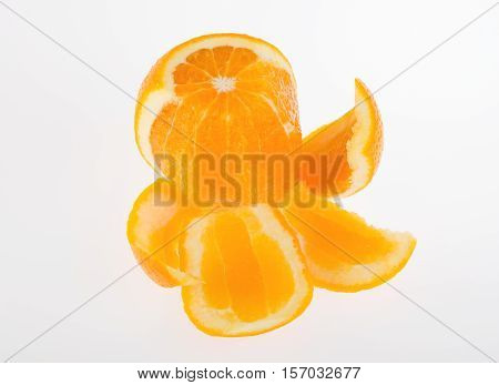 fresh peeled orange on a white background