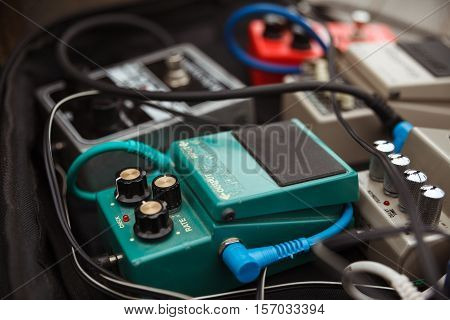 photo of electronic sound equipment amplifiers, pedals with selective focus