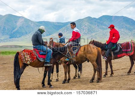 Group Of Horse Riders At Sayram Lake, China