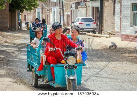 Woman Driving Kids In Motorbike Caravan