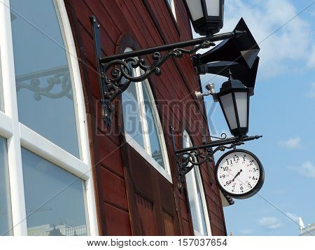 Railway station clock and retro vintage speakers on the station building. Interior times World War II.