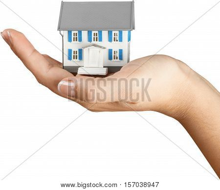 Women's Hand Holding a Model of a House - Isolated
