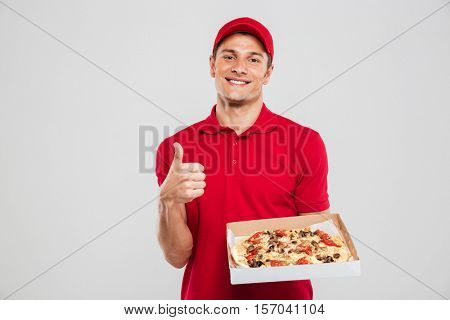 Portrait of pizza delivery man. isolated gray background