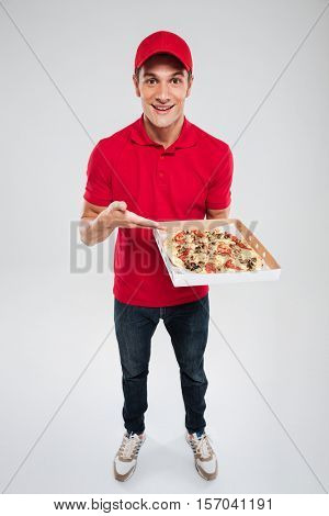 Full length of pizza delivery man. isolated gray background