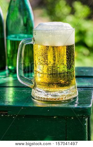 Fresh Lager Beer In Garden On Old Wooden Table